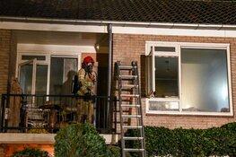 Man uit brandende woning gered