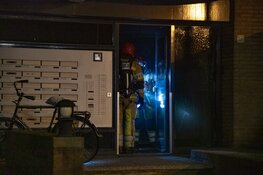 Brand in portiek, brandstichting mogelijke oorzaak